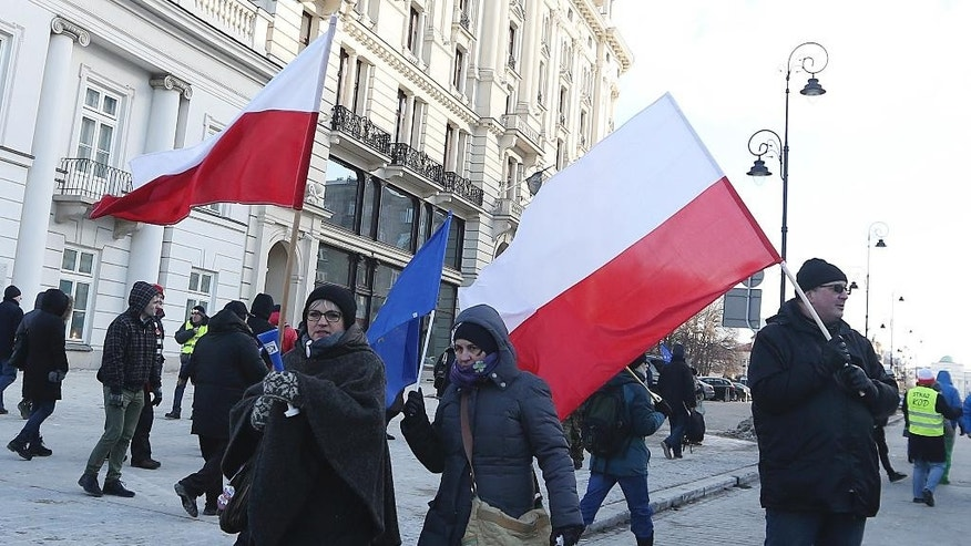 Protesters taking part in a march against the ruling party's plans to expand Poland's capital Warsaw by incorporating 32 neighboring municipalities into its administrative boundaries, in Warsaw, Poland, Saturday, Feb. 11, 2017. Opposition says the plan is designed to help the ruling Law and Justice party win control of Warsaw in 2018 local elections, something it could not achieve otherwise. (AP Photo/Czarek Sokolowski)