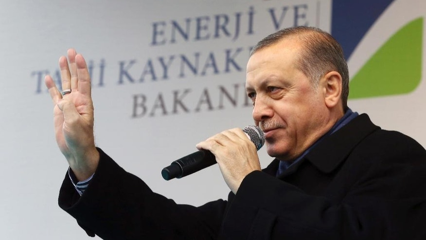 Turkish President Recep Tayyip Erdogan addresses his supporters in Aksaray, Turkey, Friday, Feb. 10, 2017. Erdogan on Friday approved holding a national referendum on constitutional reforms that would usher in a powerful presidency. Erdogan signed off on the bill, paving the way for the country's electoral board to set a date for the referendum.(Kayhan Ozer/Presidential Press Service, Pool Photo via AP)