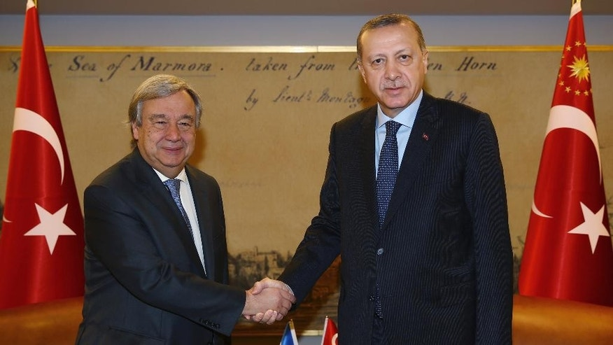 "The United Nations Secretary-General Antonio Guterres, left, and Turkish President Recep Tayyip Erdogan shake hands before a meeting in Istanbul, Saturday, Feb. 11, 2017. Guterres, the former chief of the U.N.'s refugee agency, has called Friday on nations ""to match the generosity"" of Turkey in protecting refugees, saying that too many borders are being closed and many nations are ""escaping their responsibilities."" ( Kayhan Ozer/Presidential Press Service, Pool Photo via AP)"