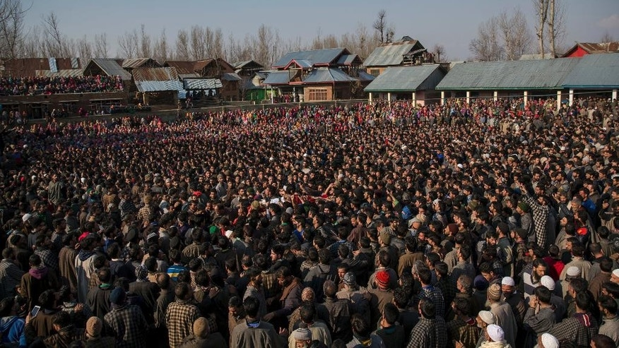 Kashmiri villagers carry the body of Mudasir Ahmed, one among four suspected rebels killed, during his funeral procession in Hawoormisshipora village, 66 Kilometers (40 miles) south of Srinagar, Indian controlled Kashmir, Sunday, Feb. 12, 2017. Four suspected rebels, two Indian army soldiers and a civilian have been killed in a fierce gunbattle in Indian-controlled Kashmir, officials said Sunday. (AP Photo/Dar Yasin)