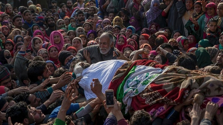 Father, center, wails near his body of Mudasir Ahmed, one among four suspected rebels killed, at his residence in Redwani, 65 kilometers (40 miles) south of Srinagar, Indian controlled Kashmir, Sunday, Feb. 12, 2017. Four suspected rebels, two Indian army soldiers and a civilian have been killed in a fierce gunbattle in Indian-controlled Kashmir, officials said Sunday. (AP Photo/Dar Yasin)