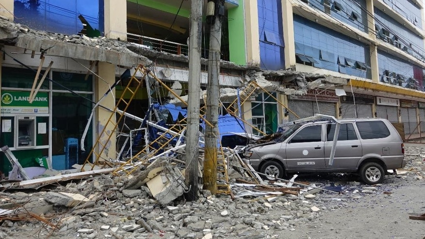 Fallen debris from a building are seen Saturday, Feb. 11, 2017 following a powerful nighttime earthquake that rocked Surigao city, Surigao del Norte province in southern Philippines. The late Friday quake roused residents from sleep in Surigao del Norte province, sending hundreds to flee their homes. (AP Photo)