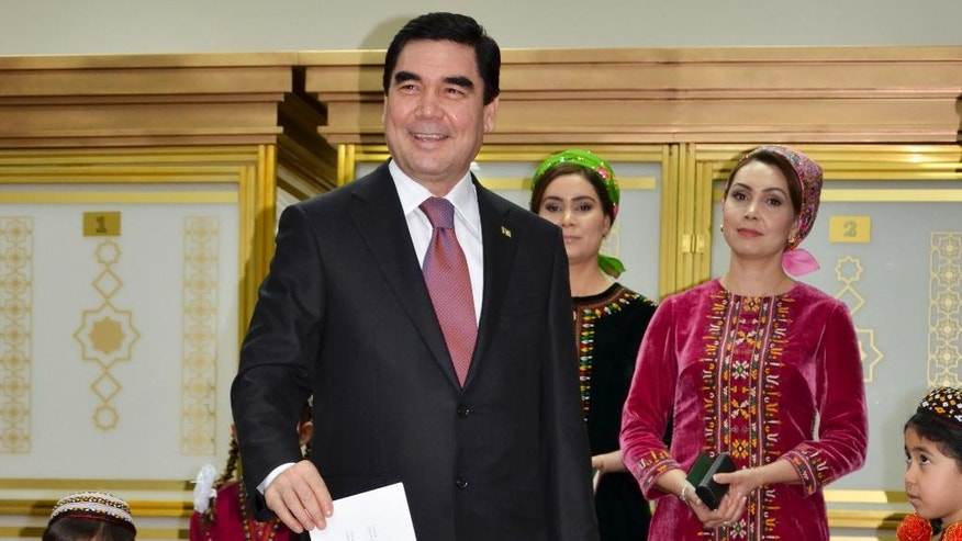 Turkmenistan President Gurbanguly Berdimuhamedov, center, smiles as he casts his ballot at a polling station in Ashgabat, Turkmenistan, Sunday, Feb. 12, 2017. Berdymukhamedov has been the overwhelmingly dominant figure in the former Soviet republic for a decade, when he assumed power after death of his eccentric predecessor Saparmurat Niyazov. (AP Photo/Alexander Vershinin)