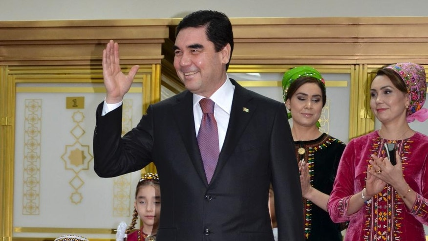Turkmenistan President Gurbanguly Berdimuhamedov, center, greets journalists after casting his ballot at a polling station in Ashgabat, Turkmenistan, Sunday, Feb. 12, 2017. Berdymukhamedov has been the overwhelmingly dominant figure in the former Soviet republic for a decade, when he assumed power after death of his eccentric predecessor Saparmurat Niyazov. (AP Photo/Alexander Vershinin)