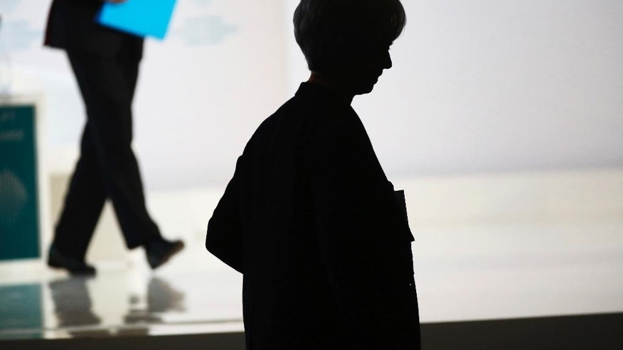 Christine Lagarde, managing director of the International Monetary Fund, walks off stage in Dubai, United Arab Emirates, Sunday, Feb. 12, 2017. Lagarde spoke as part of the World Government Summit, an annual meeting held in Dubai. (AP Photo/Jon Gambrell)
