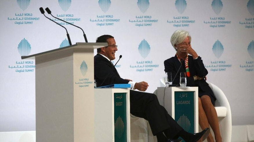 Christine Lagarde, managing director of the International Monetary Fund, reacts to a joke by Richard Quest of CNN in Dubai, United Arab Emirates, Sunday, Feb. 12, 2017. Lagarde spoke as part of the World Government Summit, an annual meeting held in Dubai. (AP Photo/Jon Gambrell)