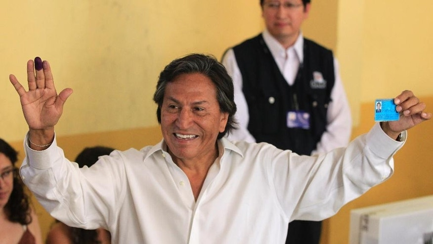 "FILE -- In this April 10, 2011 file photo, then presidential candidate Alejandro Toledo holds up his ink-stained finger and identification card after voting in the general elections, in Lima, Peru. Israeli authorities say that they will not permit Peru's fugitive former president to enter the country if he attempts to do so. In a statement, Israel's Foreign Ministry said Sunday, Feb. 12, 2017,  that Alejandro Toledo will be allowed into Israel once ""once his affairs in Peru are settled."" Toledo, who is accused of taking some $20 million in bribes, was believed to be in San Francisco over the weekend and possibly on a flight set to land in Israel later Sunday. (AP Photo/Martin Mejia, File)"