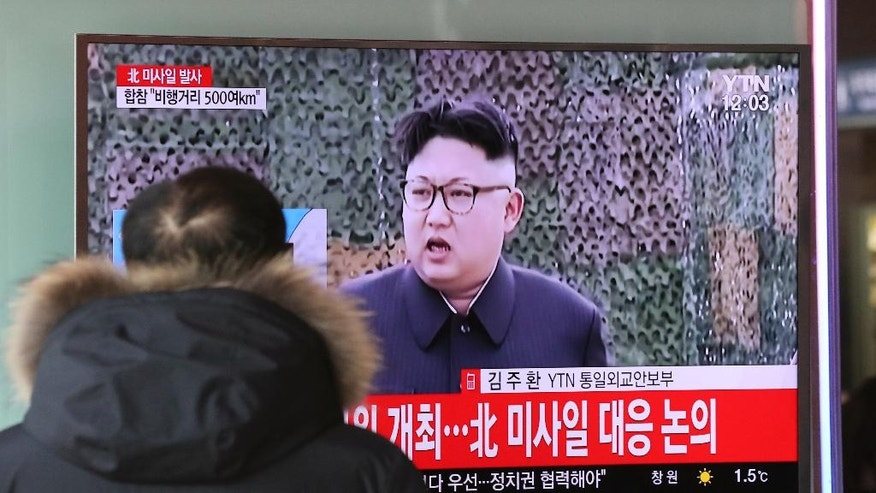 """A man watches a TV news program showing a file footage of North Korean leader Kim Jong Un with letters reading: """"The North fired a missile"""" at the Seoul Train Station in Seoul, South Korea, Sunday, Feb. 12, 2017. North Korea reportedly fired a ballistic missile early Sunday in what would be its first such test of the year and an implicit challenge to President Donald Trump's new administration. Details of the launch, including the type of missile, were scant. (AP Photo/Lee Jin-man)"""