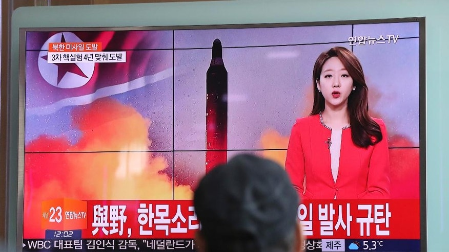 """A man watches a TV news program reporting about North Korea's missile launch with a file image of a North Korean missile at the Seoul Train Station in Seoul, South Korea, Sunday, Feb. 12, 2017. North Korea reportedly fired a ballistic missile early Sunday in what would be its first such test of the year and an implicit challenge to President Donald Trump's new administration. Details of the launch, including the type of missile, were scant. The letters read """"The ruling and the opposition parties denounce North Korea's missile launch."""" (AP Photo/Lee Jin-man)"""