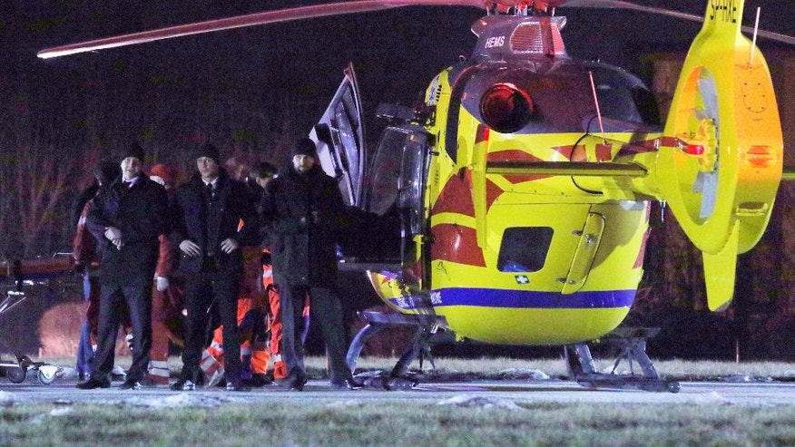 Security officers guard a rescue helicopter as Polish Prime Minister Beata Szydlo is transported to it after a car accident in Oswiecim, Poland, Friday, Feb. 10, 2017. Szydlo suffered minor injuries Friday after a small Fiat hit her car, officials and Polish news reports said. Her spokesman said she was being examined in a hospital but wasn't badly hurt. (AP Photo)
