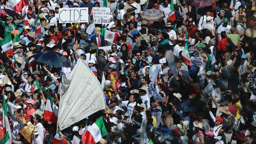 Feb. 12, 2017: Demonstrators march demanding respect for Mexico and its migrants, in the face of perceived hostility from the administration of U.S. President Donald Trump, in Mexico City.