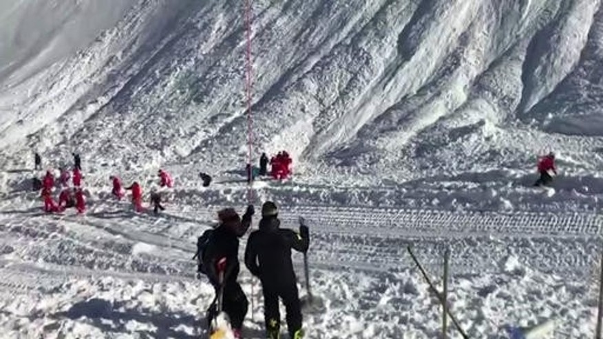 In this image taken from video, rescue personnel work at the site of the avalanche.