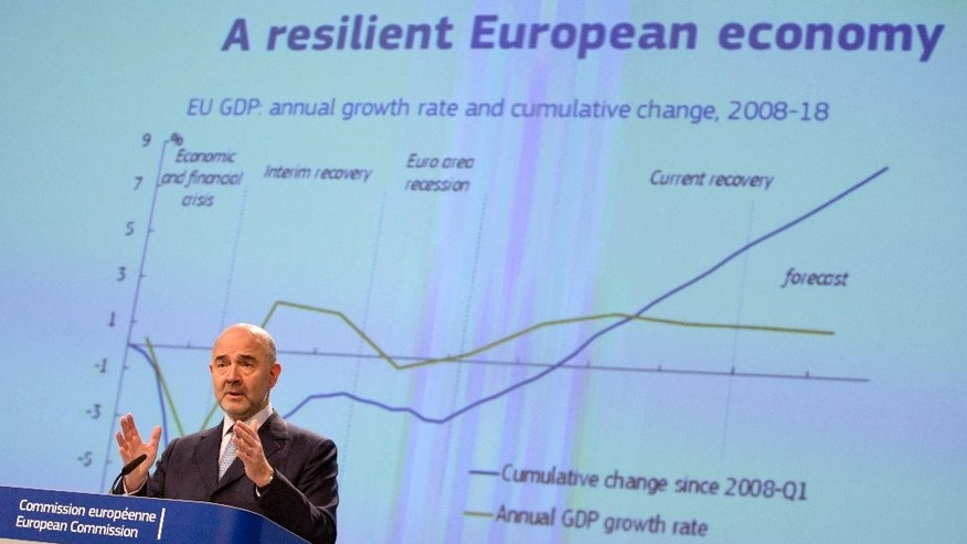 European Commissioner for Economic and Financial Affairs Pierre Moscovici speaks during a presentation of the winter economic forecast at EU headquarters in Brussels on Monday, Feb. 13, 2017. (AP Photo/Virginia Mayo)