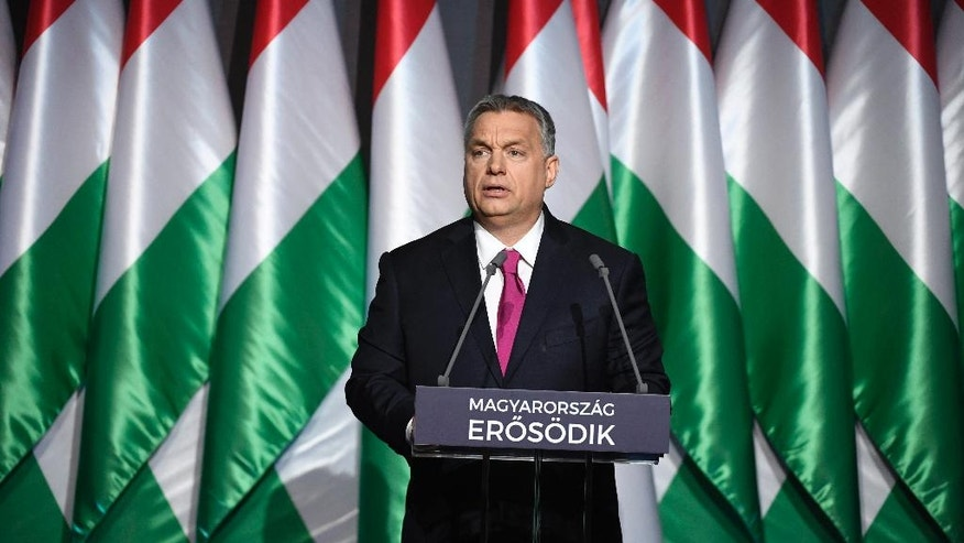 "Hungarian Prime Minister Viktor Orban delivers his annual 'State of Hungary' speech in the Varkert Bazar (Castle Gardens Bazaar) at the foot of Castle Hill in Budapest, Hungary, Friday, Feb. 10, 2017. The inscription reads: ""Hungary is getting stronger"". (Szilard Koszticsak/MTI via AP)"