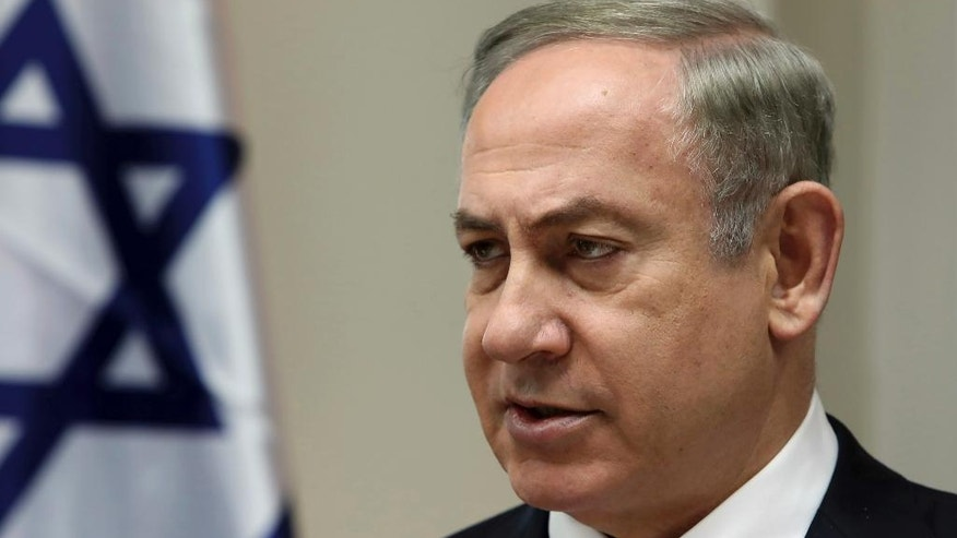 FILE - In this Sunday, Feb. 12, 2017, file photo, Israeli Prime Minister Benjamin Netanyahu chairs the weekly cabinet meeting in Jerusalem. Israel's prime minister heads to Washington this week for a high-profile meeting with President Donald Trump that is suddenly clouded in uncertainty. After embracing Israel's hard-line nationalist right throughout his presidential campaign, Trump appears to have softened some of his positions on key issues since taking office. (Gali Tibbon, Pool via AP, File)