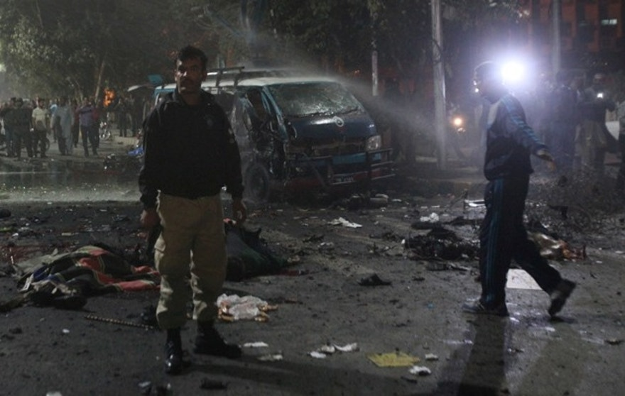ATTENTION EDITORS - VISUAL COVERAGE OF SCENES OF INJURY OR DEATH A policeman stands guard at the scene after a blast in Lahore, Pakistan February 13, 2017. REUTERS/Mohsin Raza TEMPLATE OUT - RTSYGEM