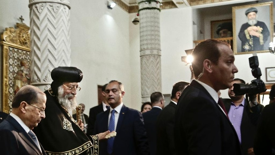 Lebanese President Michel Aoun, left, leaves after a meeting with Coptic Pope Tawadros II, second right, during his visit at St. Mark's Cathedral in Cairo, Egypt, Monday, Feb. 13, 2017. (AP Photo/Nariman El-Mofty)