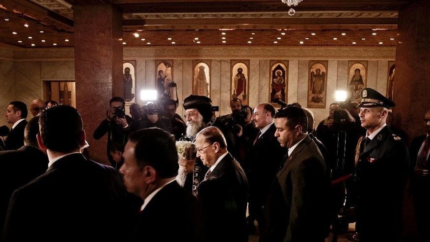 Lebanese President Michel Aoun, center, arrives to meet with Coptic Pope Tawadros II, center left, during his visit at St. Mark's Cathedral in Cairo, Egypt, Monday, Feb. 13, 2017. (AP Photo/Nariman El-Mofty)