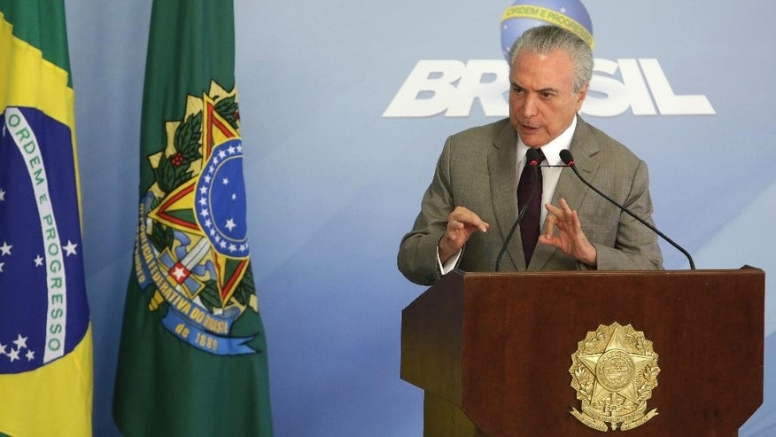 "Brazil's President Michel Temer speaks during a press conference at the Planalto Presidential Palace, in Brasilia, Brazil, Monday, Feb. 13, 2017, where he spoke on the security vacuum created by a ""police halt"" in the Brazilian state Espirito Santo. Temer called the police halt ""an insurgency against the Constitution."" Authorities have threatened to prosecute officers who do not respond to the calls to return to duty. The Brazilian Constitution prohibits police from going on strike. (AP Photo/Eraldo Peres)"