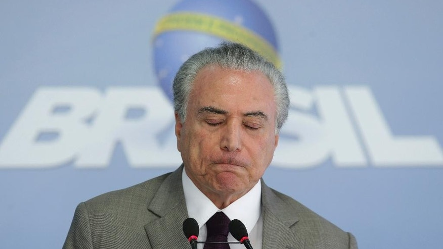 "Brazil's President Michel Temer reacts during a press conference at the Planalto Presidential Palace, in Brasilia, Brazil, Monday, Feb. 13, 2017, where he spoke on the security vacuum created by a ""police halt"" in the Brazilian state Espirito Santo. Temer called the police halt ""an insurgency against the Constitution."" Authorities have threatened to prosecute officers who do not respond to the calls to return to duty. The Brazilian Constitution prohibits police from going on strike. (AP Photo/Eraldo Peres)"