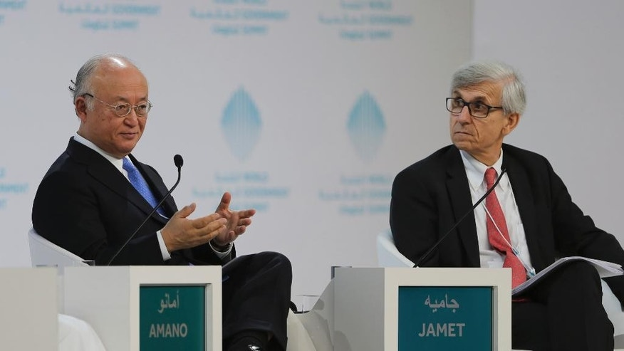 Director General of the International Atomic Energy Agency, IAEA, Yukiya Amano, left, talks next to Philippe Jamet, Commissioner of France Nuclear Safety Authority, ASN, during the last day of the World Government Summit, in Dubai, United Arab Emirates, Tuesday, Feb. 14, 2017. The head of the United Nations' atomic agency says the administration of U.S. President Donald Trump has yet to be in touch with him or others about their criticism of the Iran nuclear deal. (AP Photo/Kamran Jebreili)