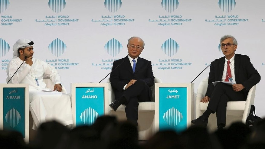 Director General of the International Atomic Energy Agency, IAEA, Yukiya Amano, middle, listens to Philippe Jamet, right, Commissioner of France Nuclear Safety Authority, during a discussion moderated by Ambassador Hamad Al Kabbi, Permanent Representative of the UAE to the IAEA, on the last day of the World Government Summit in Dubai, United Arab Emirates, Tuesday, Feb. 14, 2017. The head of the United Nations' atomic agency says the administration of U.S. President Donald Trump has yet to be in touch with him or others about their criticism of the Iran nuclear deal. (AP Photo/Kamran Jebreili)