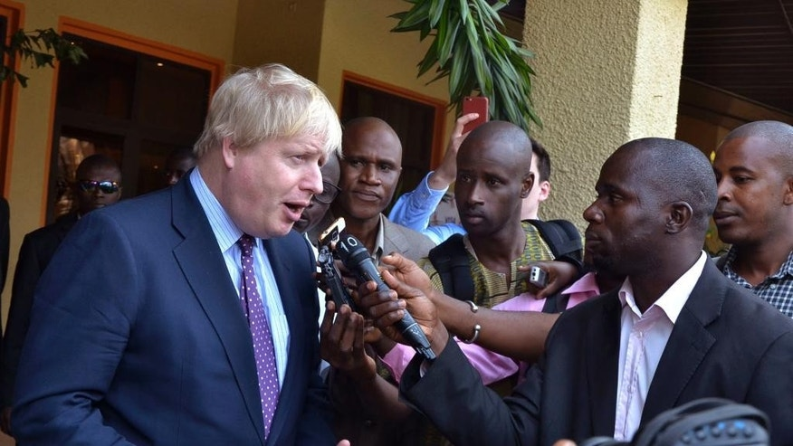 Britain's Foreign Secretary Boris Johnson speaks to media before meeting with Gambian President Adama Barrow for talks in Banjul, Gambia, Tuesday, Feb. 14, 2017. (AP Photo/ Kuku Marong)