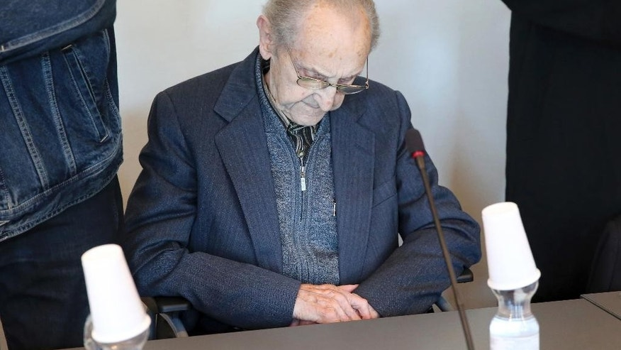 FILE - In this Sept. 12, 2016 file photo Hubert Zafke sits in a courtroom ahead of his trial in Neubrandenburg, eastern Germany. The former SS medic who served at the Auschwitz death camp is on trial in the northern German city of Neubrandenburg. (Bernd Wuestneck/dpa via AP)