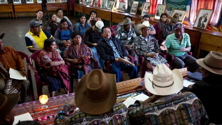 In this Jan. 16, 2017 photo, residents listen to indigenous authorities acting as judges during a hearing related to a territorial limit conflict in their community, at the Indigenous City Hall in the Indian town of Solola, Guatemala. Here justice works as it has for centuries: Townsfolk bring grievances and local authorities make rulings, usually with a speed unheard of in a country where justice is often delayed, if it comes at all. (AP Photo/Moises Castillo)