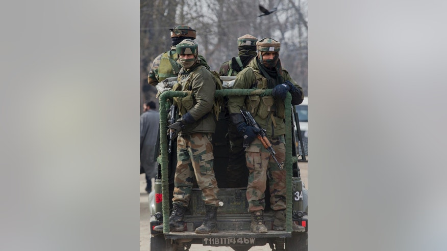 Indian army soldiers leave the site of a gun battle with suspected rebels in Hajin Village some 38 kilometers (23.75 miles) northeast of Srinagar, Indian controlled Kashmir, Tuesday, Feb. 14, 2017. Three Indian army soldiers and a suspected rebel were killed in the gun battle in the Indian portion of Kashmir on Tuesday, officials said. (AP Photo/Dar Yasin)