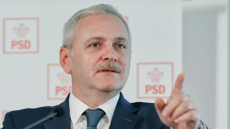 FILE - In this file photo taken on Wednesday, Dec. 7, 2016, Liviu Dragnea, the leader of the Social Democratic party attends a press conference in Bucharest, Romania. The chairman of Romania's ruling Social Democratic Party has denied, Tuesday, Feb. 14, 2017, wrongdoing in a trial where he is charged with putting no-work jobs on the government payroll. (AP Photo/Vadim Ghirda, File)