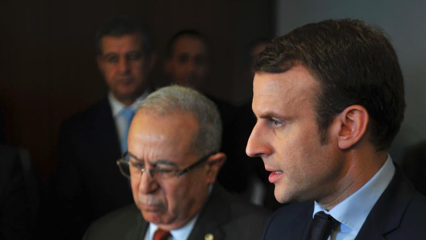 French Presidential candidate Emmanuel Macron, right, answers reporters with Algerian Foreign Minister Ramtane Lamamra in Algiers, Monday Feb. 13, 2017. Claims made by Macron's campaign chairman Richard Ferrand Monday, assert that Russian groups are interfering with his presidential campaign but have offered little evidence to back up the claim. (AP Photo/Anis Belghoul)