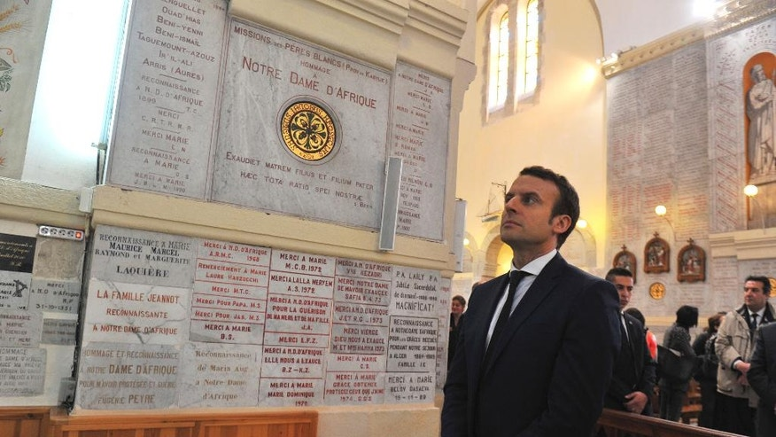 French Presidential candidate Emmanuel Macron visits the Notre-Dame d'Afrique basilica in Algiers, Tuesday Feb. 14, 2017. Macron ends his two-day visit to Algeria. (AP Photo/Anis Belghoul)