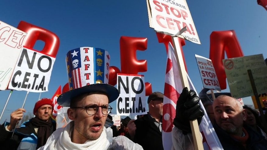 Demonstrators march against the so-called CETA trade deal near the European Parliament in Strasbourg, eastern France, Wednesday, Feb.15, 2017. The European Union's parliament approved a trade deal with Canada, extolling the pact as a sign of cooperation at a time when many political forces, including U.S. President Donald Trump's administration, are trying to halt globalization. (AP Photo/Jean-Francois Badias)