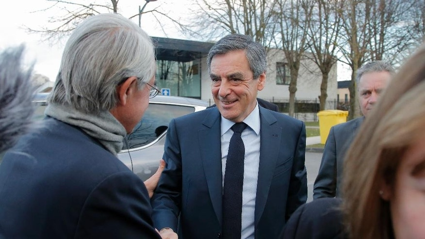 French conservative presidential candidate Francois Fillon arrives in Compiegne, north of Paris, for a meeting on security matters, Wednesday, Feb. 15, 2017. Fillon's campaign has been flailing since weekly newspaper Le Canard Enchaine revealed that his wife and children were paid public funds for allegedly fake jobs as his parliamentary aides. (AP Photo/Michel Euler)