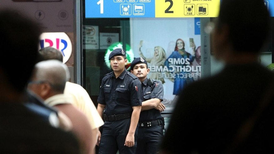 Police officers patrol inside the Kuala Lumpur International Airport in Sepang, Malaysia, Wednesday, Feb. 15, 2017. Kim Jong Nam, the half brother of North Korean leader Kim Jong Un, was assassinated Monday at the airport, telling medical workers before he died that he had been attacked with a chemical spray, a Malaysian official said Tuesday. (AP Photo)