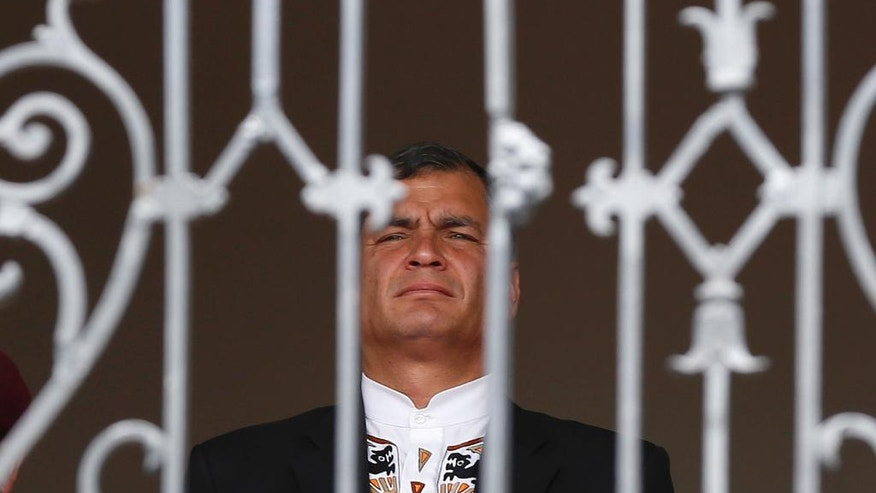 FILE - In this Nov. 10, 2014 file photo, Ecuador's President Rafael Correa waits for the start of a head of state visit at the entrance of the government palace in Quito, Ecuador. For the first time in a decade, Correa won't be running when Ecuadoreans head to the polls on Sunday, Feb. 19, 2017, to elect his successor. (AP Photo/Dolores Ochoa, File)