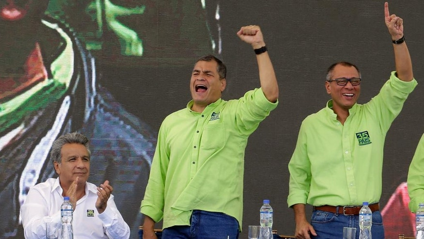 FILE - In this Oct. 1, 2016 file photo, human rights activist and former vice president, Lenin Moreno, left, Ecuador's President Rafael Correa, center, and Vice President Jorge Glas, sing during the Alianza PAIS party convention where Moreno was chosen as the ruling party presidential candidate, and Glas as his running mate, in Quito, Ecuador. Although congress in 2015 approved a constitutional amendment lifting presidential term limits, Correa rejected calls by supporters to run for a fourth time. (AP Photo/Dolores Ochoa, File)