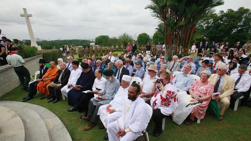 Religious leaders, first row, and guests attend the 75th anniversary of the Fall of Singapore at the Kranji War Cemetery on Wednesday, Feb. 15, 2017, in Singapore. (AP Photo/David Loh)