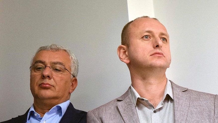 "In this Friday, Sept. 23, 2016 photo, two senior opposition leaders Andrija Mandic, left, and Milan Knezevic attend a press conference in Podgorica, Montenegro. Montenegro's Prime Minister Dusko Markovic said Tuesday, Feb. 14, 2017 that those who want to destabilize the country by meddling into its affairs ""should keep their hands off Montenegro."" (AP Photo/Risto Bozovic)"