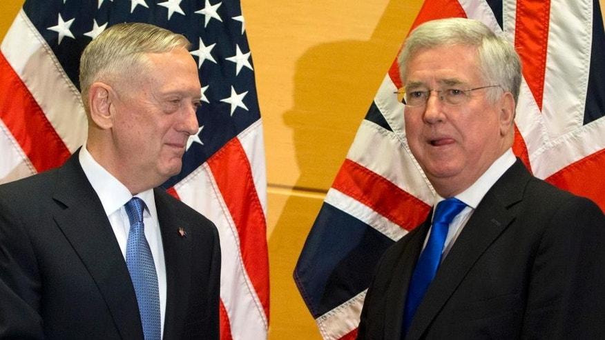 U.S. Secretary of Defense Jim Mattis, left, speaks with British Secretary of State for Defense Michael Fallon during a meeting at NATO headquarters in Brussels on Wednesday, Feb. 15, 2017. For U.S. Defense Secretary Jim Mattis, the next few days will be a reassurance tour with a twist. He is expected to tell allies the U.S. is committed to NATO and is also hoping to secure bigger defense spending commitments. (AP Photo/Virginia Mayo, Pool)