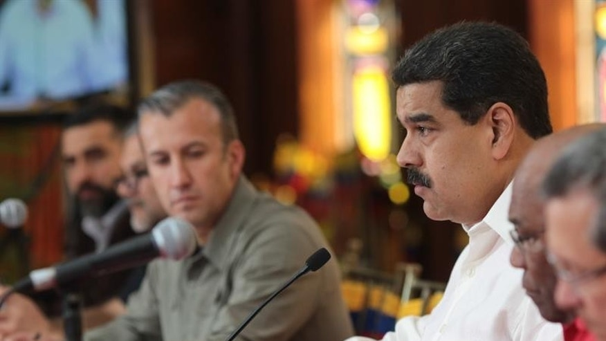 Venezuela's President Nicolas Maduro (R) with Vice President Tareck El Aissami during a press conference in Caracas, Venezuela, Feb. 14, 2017.
