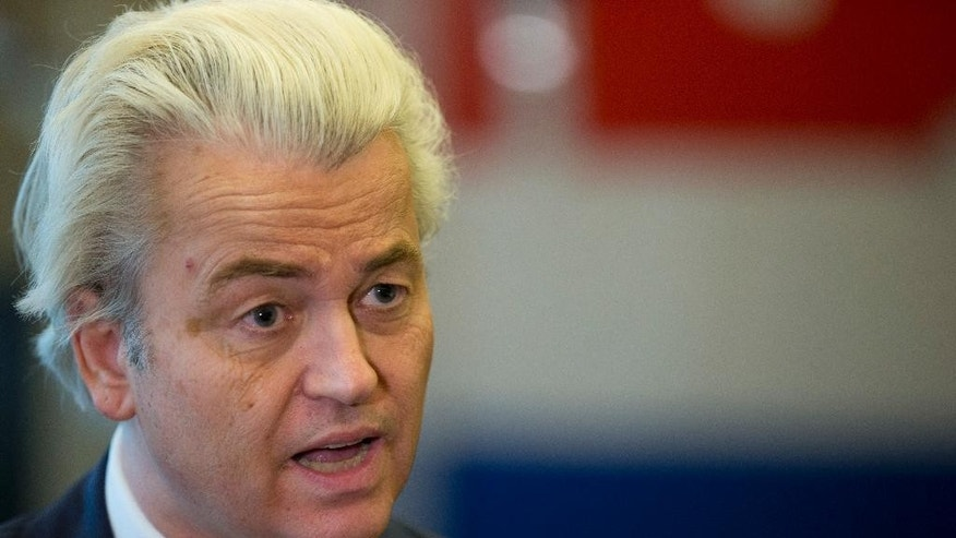 "Firebrand anti-islam lawmaker Geert Wilders answers questions as the Dutch flag is seen in the background during an interview in The Hague, Netherlands, Thursday, Feb. 16, 2017. Now, as a March 15 parliamentary election looms, the political mood is turning inward as Wilders dominates polls with an isolationist manifesto that calls for the Netherlands ""to be independent again. So out of the EU."" (AP Photo/Peter Dejong)"