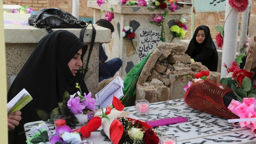 "In this Wednesday, Feb. 15, 2017 photo, family members of Iraqi Army officer, Hamza Finjan, pray over his grave in Wadi al-Salam, or ""Valley of Peace"" cemetery which contains the graves of security forces and militiamen killed from fighting with Islamic State group militants, in Najaf, 100 miles (160 kilometers) south of Baghdad, Iraq. Hundreds of Iraqi soldiers are estimated to have died in the fight for Mosul so far, but the Iraqi government does not release official casualty reports, a move that many Iraqis view as disrespectful of their sacrifice. (AP Photo/ Khalid Mohammed)"
