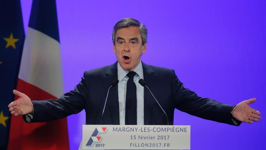 French conservative presidential candidate Francois Fillon gestures as he speaks during a campaign meeting in Compiegne, north of Paris, Wednesday, Feb. 15, 2017. Conservative French presidential candidate Francois Fillon wants to prosecute 16 and 17-year-olds as adults, arguing it would prevent the kind of unrest that has rocked the low-income suburbs of Paris following an alleged police rape. (AP Photo/Michel Euler)