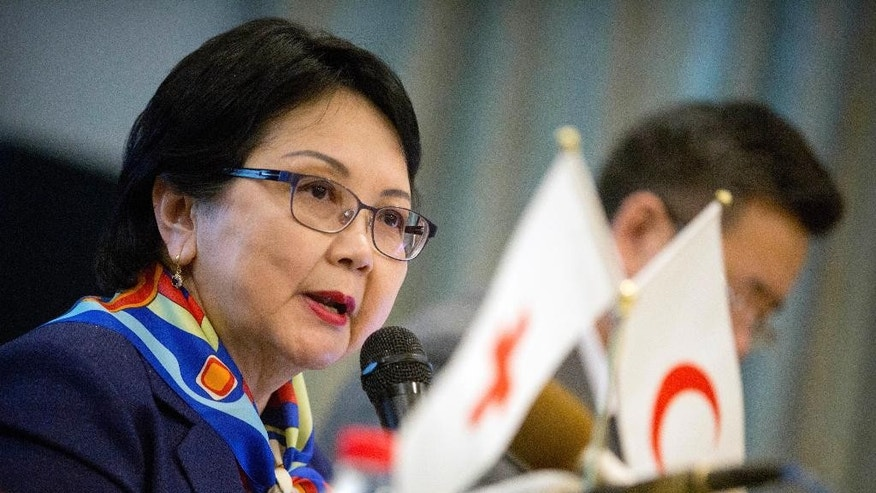 "Bolormaa Nordov, secretary-general of the Mongolian Red Cross Society, speaks about harsh Mongolian weather conditions known as ""dzud"" at a press briefing in Beijing Thursday, Feb. 16, 2017. The Red Cross said exceptionally cold weather is putting the livelihoods of thousands of Mongolian herders at risk just one year after another extreme winter killed more than 1 million animals. (AP Photo/Mark Schiefelbein)"