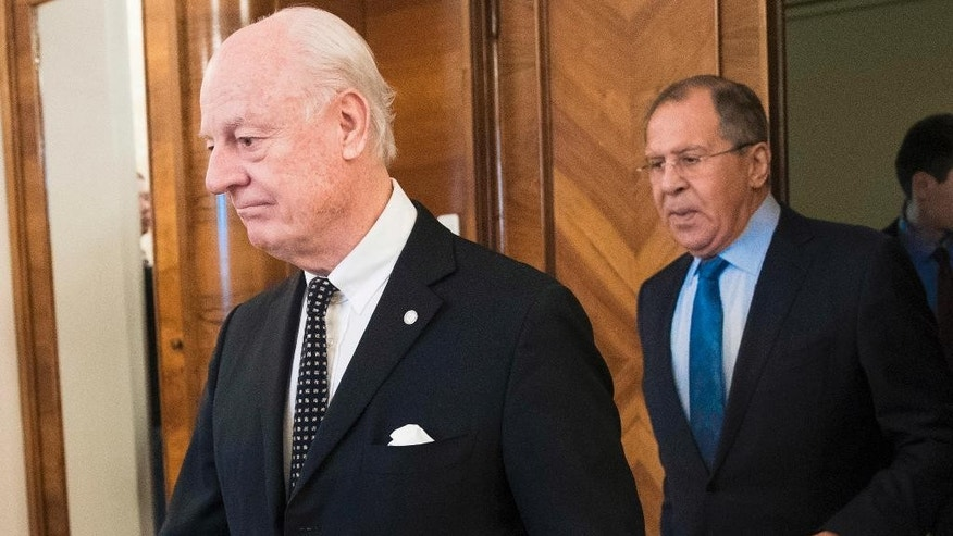 U.N. Special Envoy for Syria Staffan de Mistura left and Russian Foreign Minister Sergey Lavrov right enter a hall for talks in Moscow Russia Thursday Feb. 16 2017