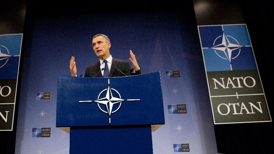 NATO Secretary General Jens Stoltenberg speaks during a media conference at NATO headquarters in Brussels on Thursday, Feb. 16, 2017. Germany on Thursday signed a series of agreements with its NATO partners to jointly buy transport aircraft and submarines and develop new weapons. (AP Photo/Virginia Mayo)