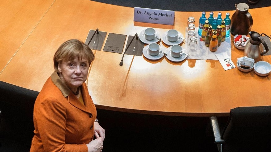 German Chancellor Angela Merkel waits for the beginning of a questioning at an investigation committee of the German federal parliament looking into alleged U.S. surveillance in Germany and the activities of Germany's own foreign intelligence service in Berlin, Germany, Thursday, Feb. 16, 2017. (Bernd von Jutrczenka/dpa via AP)