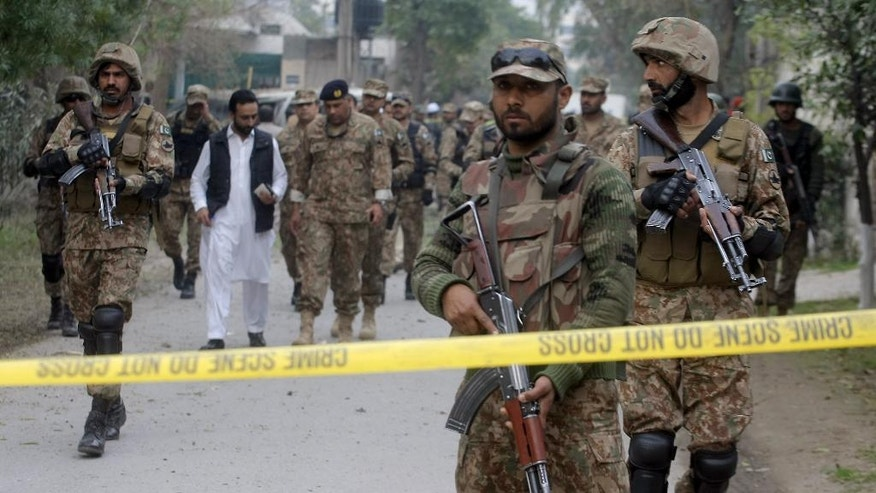 Pakistan army soldiers cordon off the area of a bombing in Peshawar, Pakistan, Wednesday, Feb. 15, 2017. Two suicide bombings in northwestern Pakistan killed at least 6 people on Wednesday following an almost three-month-long lull in the volatile region. A breakaway Taliban faction claimed responsibility for one of the attacks. (AP Photo/Mohammad Sajjad)